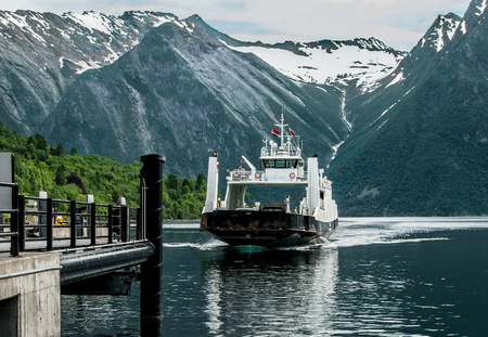 Norway Ferry Boat Landing:  A boat carrying passengers and vehicles