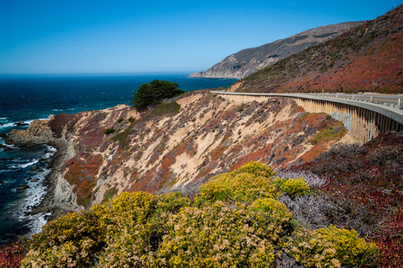 California Route 1: Californias coastal highway curves along the side of a steep cliff in the Big Sur area south of Monterey.