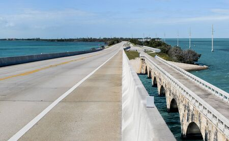 Overseas Highway:  A modern bridge passes beside its older counterpart (now a fishing pier) as US Route 1 connects the Florida Keys and divides the Atlantic Ocean from the Gulf of Mexico.