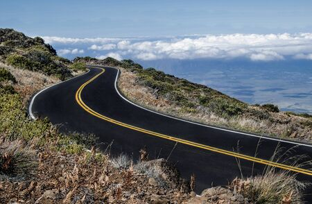 Maui Mountain Road:  The road from the top of Mt. Haleakal� begins above the clouds and descends through arid terrain to a tropical valley below.