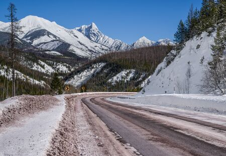 Scenic Winter Drive in Montana A snowy mountain road curves through a portion of Glacier National Park that remains open all year.