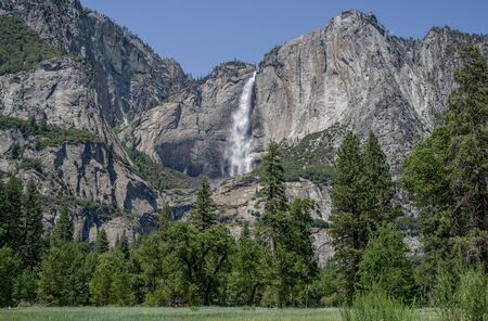 Yosemite Falls in July:  Water from melting snow cascades over a cliff to form the highest waterfall in Yosemite National Park and one of the highest in North America.