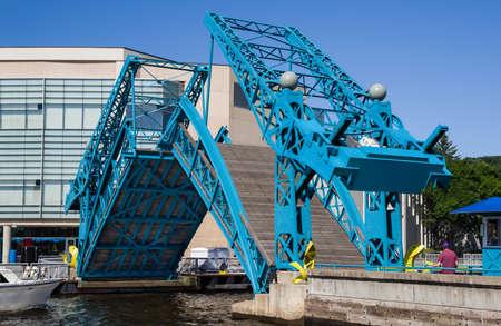 Pedestrian Drawbridge: The sides of a foot bridge tilt upward to allow passage of boats through the harbor in Duluth, Minnesota.