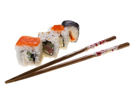 Different sushi with sticks on the isolated background photo