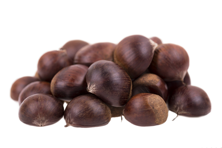 cleared: the cleared edible chestnuts on the isolated background Stock Photo
