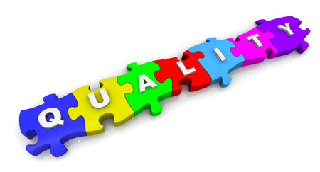 Quality. Inscription on the multicolored puzzles Stok Fotoğraf