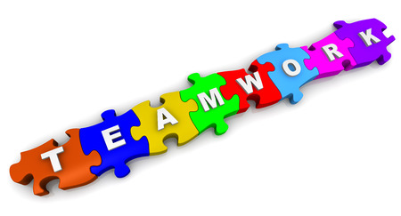 compiled: Teamwork. Inscription on the multicolored puzzles Stock Photo