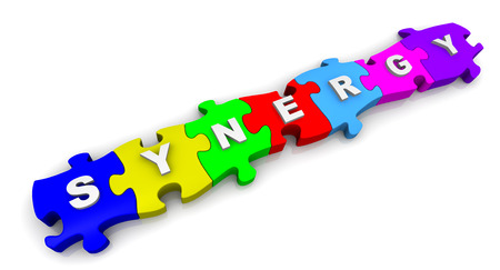 synergy: Synergy. Word on puzzles Stock Photo