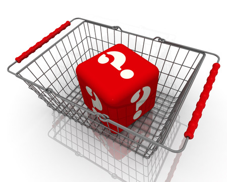 shopping questions: Cube with question symbols in the shopping basket Stock Photo