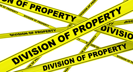 the property: Yellow warning tapes with inscription DIVISION OF PROPERTY. Isolated