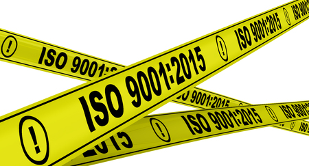 ISO 9001: 2015. Yellow warning tapes 免版税图像
