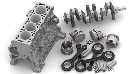 Details of the internal combustion engine lying on a white surface Stockfoto