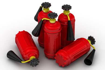Red fire extinguishers on a white surface Stock Photo