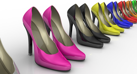 foot gear: Multicolored womens shoes with high heels standing in a row on a white surface