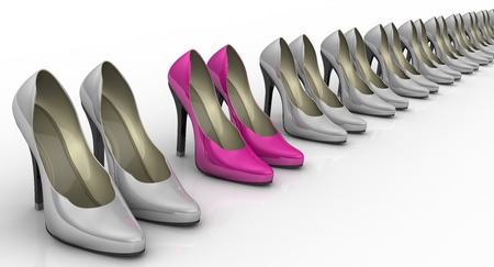 a7a5f95b64ae Pink women s shoes with high heels standing in a row among gray shoes on a  white