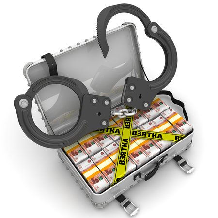 Bribe. Suitcase full of money with handcuffs Stock Photo