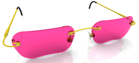 Gold eyewear with pink glasses lie on a white surface Stock Photo