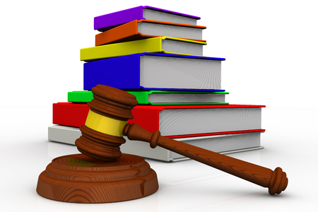judicial proceeding: Judges hammer and a pile of books on white surface