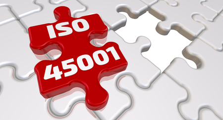 ISO 45001. Folded white puzzles elements and one red with text ISO 45001 - is an International Standard that specifies the requirements for an occupational health and safety management system. 3D Illustration Фото со стока