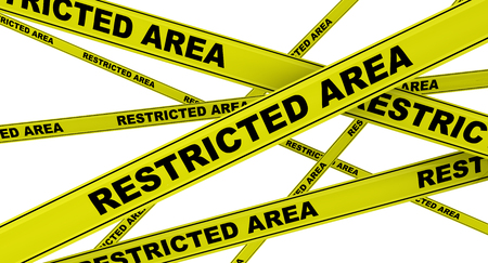 RESTRICTED AREA. Yellow warning tapes Stock Photo