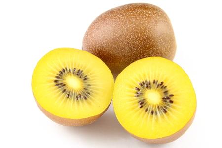 白い背景で隔離の新鮮な黄色のキウイ フルーツの組成 写真素材
