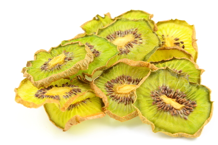 kiwi fruta: composition of dried slices of kiwi fruits isolated on a white background