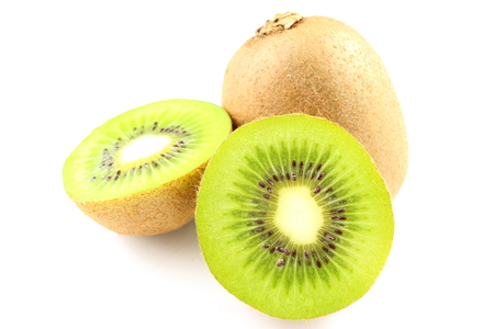 actinidia deliciosa: composition of fresh green kiwi fruits isolated on a white background