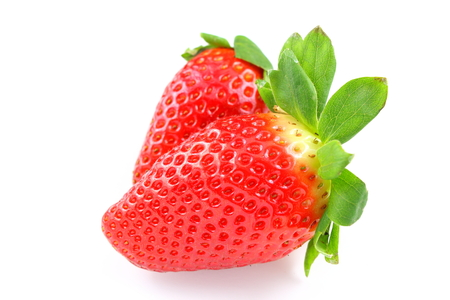 composition of fresh garden strawberry fruits isolated on a white background Stock Photo
