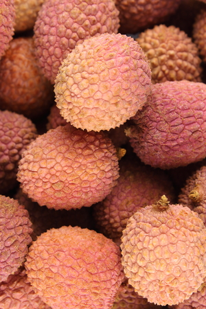 herbalism: composition of lychee fruits closeup food background texture