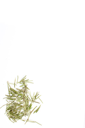 flavouring: dried rosemary leaves isolated on a white background as a food background texture