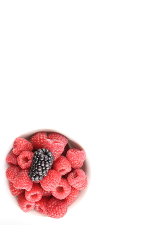 herbalism: fresh blackberry and red raspberry fruits in a small bowl Stock Photo