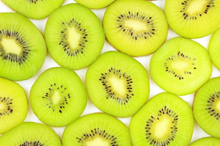 slices of fresh green kiwi fruits as a food background texture Imagens