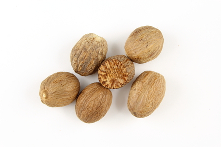 composition of nutmeg seeds isolated on a white background Stock Photo