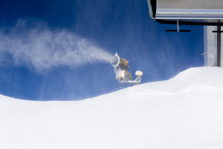 maschine: Snow maschine or snow cannon making snow Stock Photo