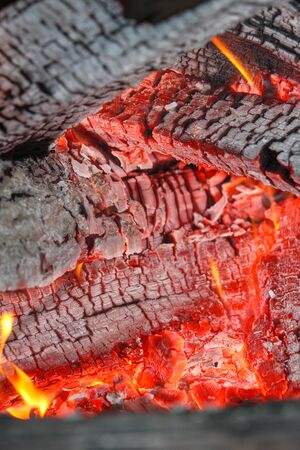 The hot embers of burning wood log fire