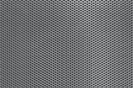 Texture photo of grey perforated metal