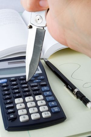 A knife attacking a calculator out of frustration.