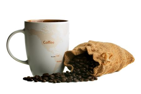 Coffee mug with a sack of fresh beans against a white background with shadows.