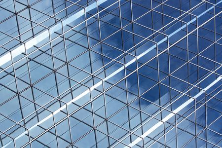 postmodern: Photo of interesting reflection details in the corner of a steel frame curtain wall structure. Stock Photo