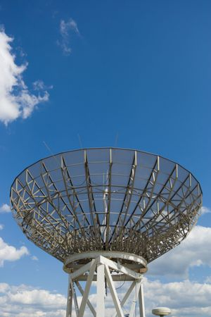 A small radio telescope pointed up at the stars. Stock fotó