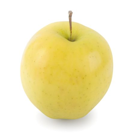 Golden Delicious apple against a white background with shadows.