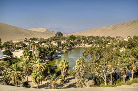 The oasis of Huacachina in the desert of Ica, Peru Фото со стока
