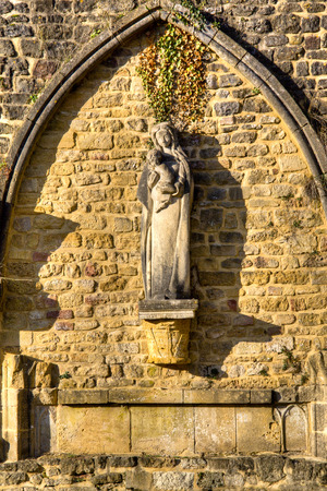 walloon: Statue of Mother Mary at the abbey in Orval, Belgium is famous for its trappist beer, botanical garden and ruins of the former monastery Stock Photo