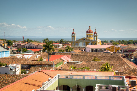View of the historical center of Granada, Nicaragua with several cathedrals, churches and the lake in the background