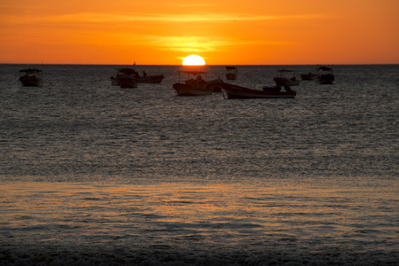 bl: Sunset over the sea with boats in the background in the bay of San Juan del Sur in Nicaragua