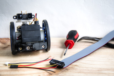 Building a robot with motors wheels and a sensor with wires and basic tools