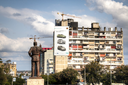 appartment: Statue of president Samora of Mozambique with appartment building in Maputo, the capital of Mozambique