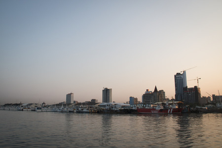 Boats in the harbour of Maputo, the capital of Mozambique with the skyline in the back Фото со стока