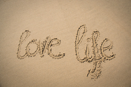 love life: The words love life written in the sand on a beach in Mozambique
