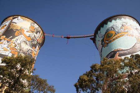 poorness: The Orlando Towers in Soweto, a township of Johannesburg in South Africa. Between the towers is a bridge for bungee jumping